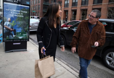 Maria Kim, left, thanks UberEats driver Jim Butler for delivering her lunch in Chicago on Tuesday, Dec. 22, 2015. (Terrence Antonio James/Chicago Tribune/TNS)